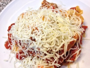 slow cooker lasagna garnished with Italian cheese