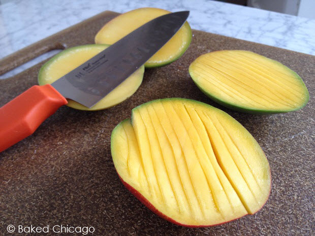 slicing mango for the coconut-mango upside down baked French toast #shop #JungleFresh